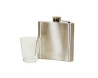 Flask and shot glass Royalty Free Stock Images
