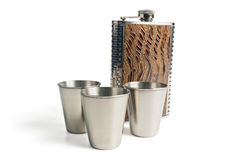 Flask and shot glasses Stock Photo