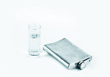 Flask of vodka and a glass Stock Photography