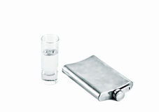 Flask of vodka and a glass Stock Photos
