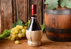 Flask of wine and bunch of grapes Royalty Free Stock Photo