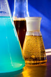 Flask with yellow liquid. Nucleate boiling in flask with yellow liquid Royalty Free Stock Photography