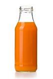 Flaska av morotfruktsaft Arkivbilder