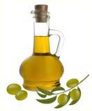 Flaska av olivolja med oliv Arkivfoto