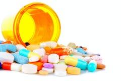 Flaska av spill av medicin Arkivfoto
