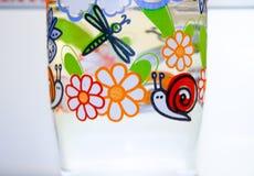 flaska av vatten med färger Arkivbilder