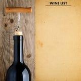Flaska av vin och vinlistan Arkivfoto