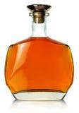 Flaska av whisky på en vit bakgrund Arkivfoto