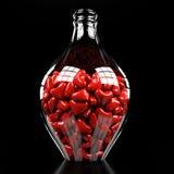 Flaska med hjärtor Arkivbild