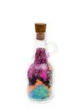 Flaska med kulör sand royaltyfria foton
