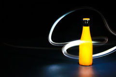 Flaska med ljus målning  Arkivfoton