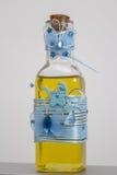 Flaska med olja för christening royaltyfria bilder