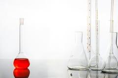 Flaska med röd flytande Fotografering för Bildbyråer