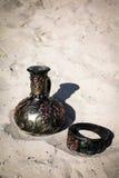 Flaska och armband Royaltyfri Foto