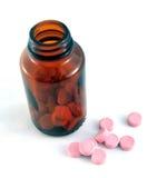 Flaska och preventivpillerar Arkivfoto