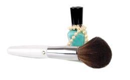 Flaskan av spikar polishe- och makeupborsten Arkivfoto