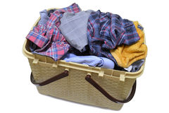 Flasket. Full of clothes on white background Stock Images