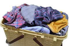 Flasket. Full of clothes on white background Royalty Free Stock Images