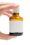 flaskholdingmedicin royaltyfri bild