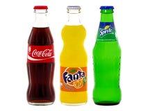 Flaskor av cocaen - cola, Fanta och Sprite arkivfoton