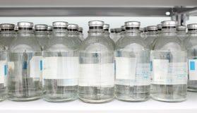 Flaskor av kemikalieer i lager royaltyfria foton