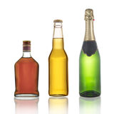Flaskor av konjak, champagne och öl royaltyfria foton
