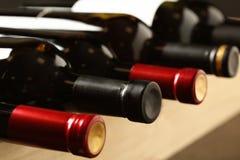 Flaskor av olika viner Dyr samling royaltyfria bilder