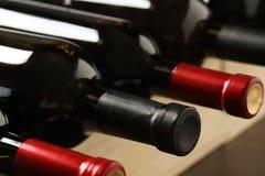 Flaskor av olika viner Dyr samling fotografering för bildbyråer