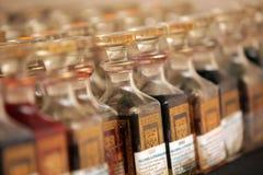 Flaskor av parfymerade oljor Royaltyfri Foto
