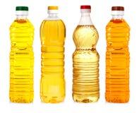 Flaskor av solrosolja som isoleras på vit bakgrund Royaltyfria Bilder