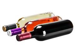 Flaskor av vin av olika typer som isoleras på en vit backgroun Royaltyfri Fotografi