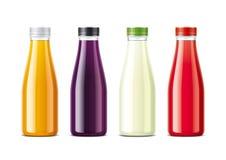 Flaskor för fruktsaft och sodavatten Royaltyfria Foton