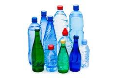 flaskor isolerat vatten Royaltyfri Foto