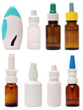 Flaskor med nasala droppar för sprej som isoleras på vit Royaltyfria Foton