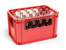 Flaskor med sodavatten eller cola i den röda stragespjällådan för flaskor Arkivbild