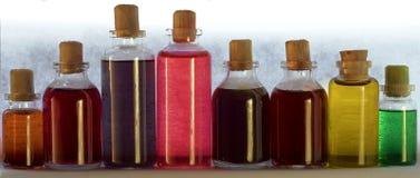 Flaskor på grå bakgrund Fotografering för Bildbyråer