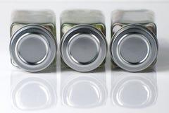 flaskor reflekterad krydda Arkivfoto