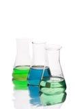 Flaskor som isoleras på vit bakgrund Fotografering för Bildbyråer