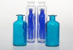 Flaskorna och deras glass trasparency Arkivbilder