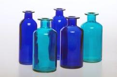 Flaskorna och deras glass trasparency Royaltyfri Bild