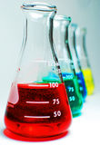 Flasks. Erlenmeyer Flasks filled with liquids in a variety of colours Stock Photo