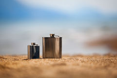 Flasks on beach Royalty Free Stock Images