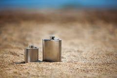 Flasks on beach Stock Photography