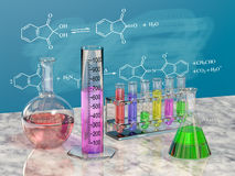 Flasks chemistry. And board with chemical formulas Stock Photography