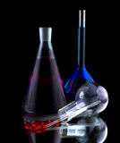 Flasks with colored liquids Stock Images