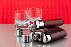 Flasks and empty glasses. On a counter Royalty Free Stock Photos