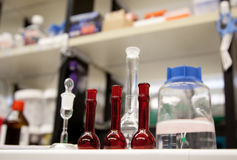 Flasks on a lab bench. Royalty Free Stock Photo