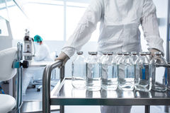 Flasks with liquids in a lab. Pharmaceutical industry factory and production laboratory color toned image; shallow DOF Royalty Free Stock Images