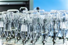 Flasks and test tubes set in the tray industrial dishwasher. Flasks and test tubes installed in the tray of industrial dishwasher mashiny.Malaya depth of field Royalty Free Stock Photography