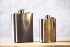 Flasks on wooden table Stock Photo